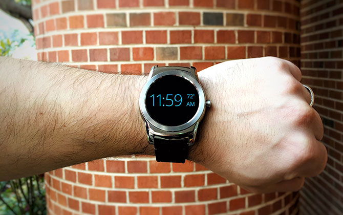Man uses smart watch to check the time at the last minute.]